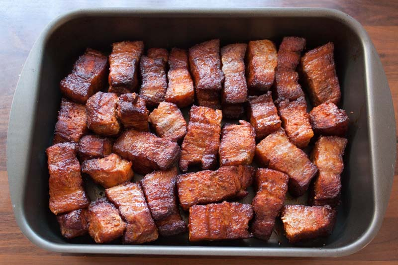 Pork belly burnt ends in a pan